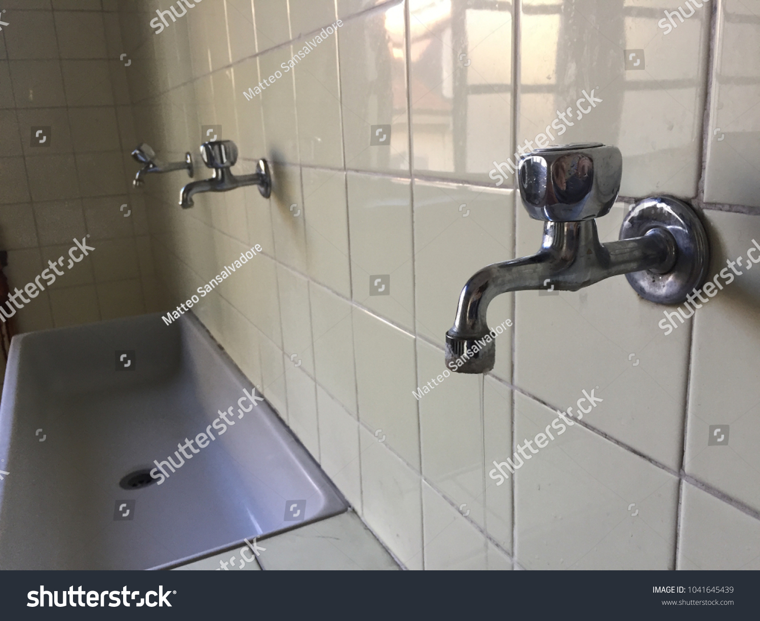 This Photo Sinks Taps Inside Old Stock Photo (Edit Now) 1041645439 ...