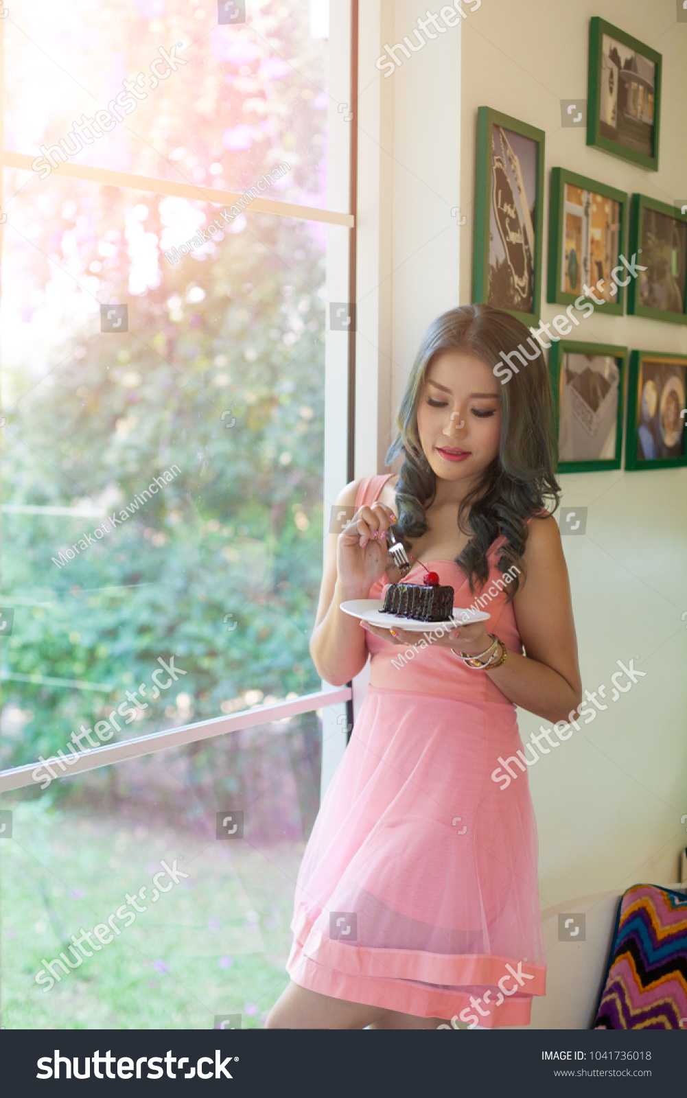 gorgeous smiling young asia woman eating stock photo edit now