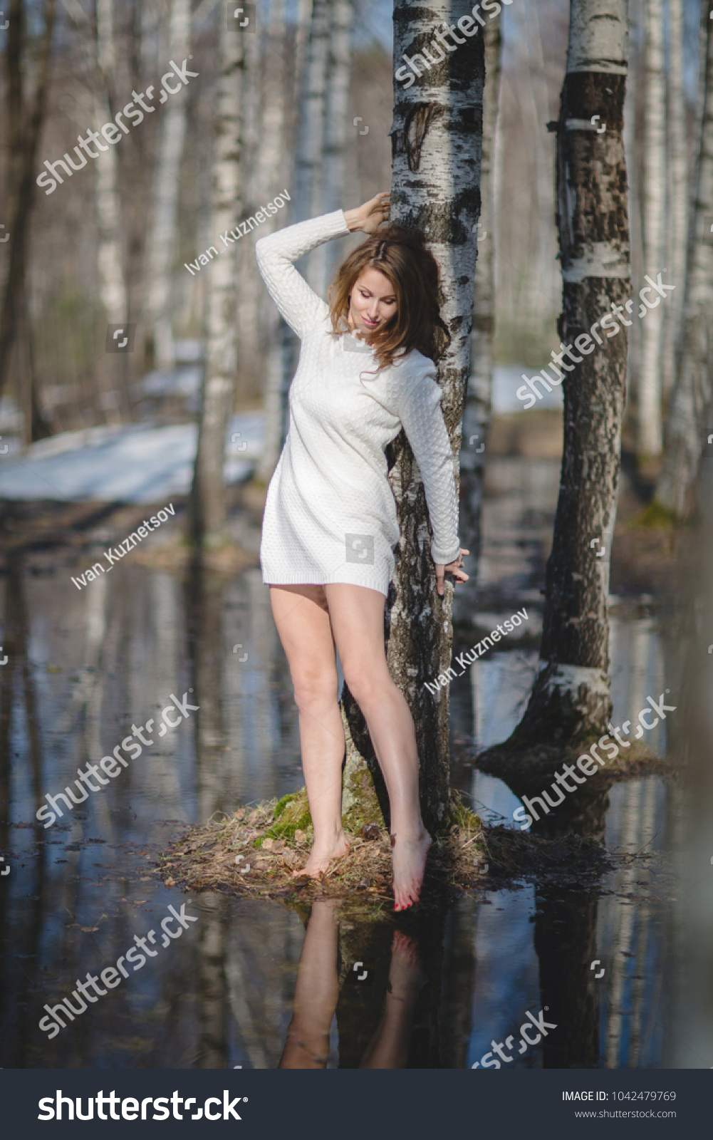 https://image.shutterstock.com/shutterstock/photos/1042479769/display_1500/stock-photo-beautiful-young-russian-girl-with-bare-feet-touching-the-water-with-her-toes-in-the-spring-forest-1042479769.jpg