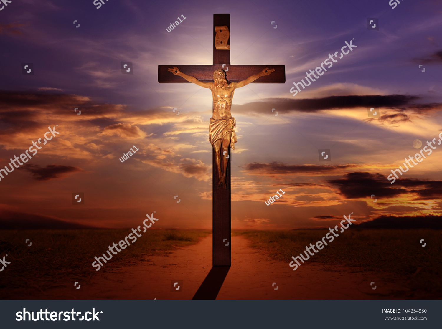 crucifixion jesus on cross sun rays stock photo 104254880