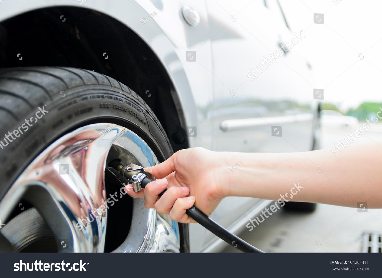 Where Can I Get High Pressure Air : Checking tire pressure pumping air into auto wheel