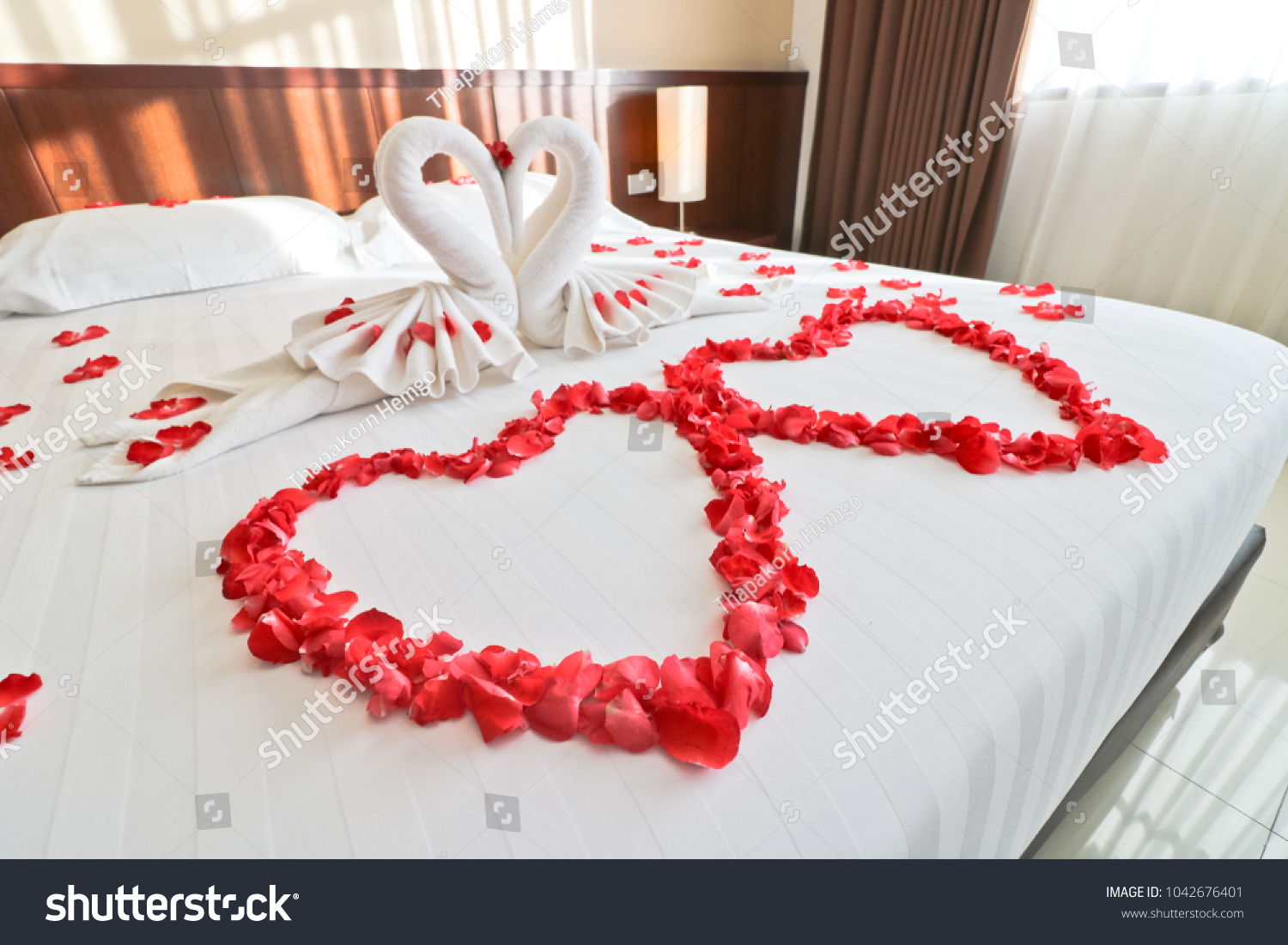 Bedroom Has White Towel Shaped Like Stock Photo Edit Now 1042676401