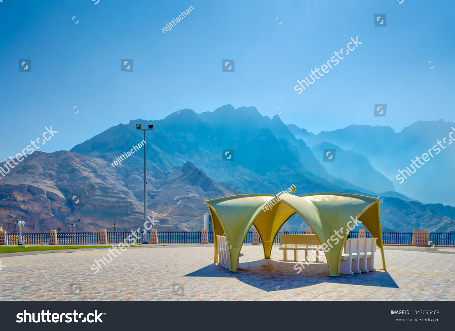 Resting place in the garden and an ideal picnic spot with high mountains and blue sky.