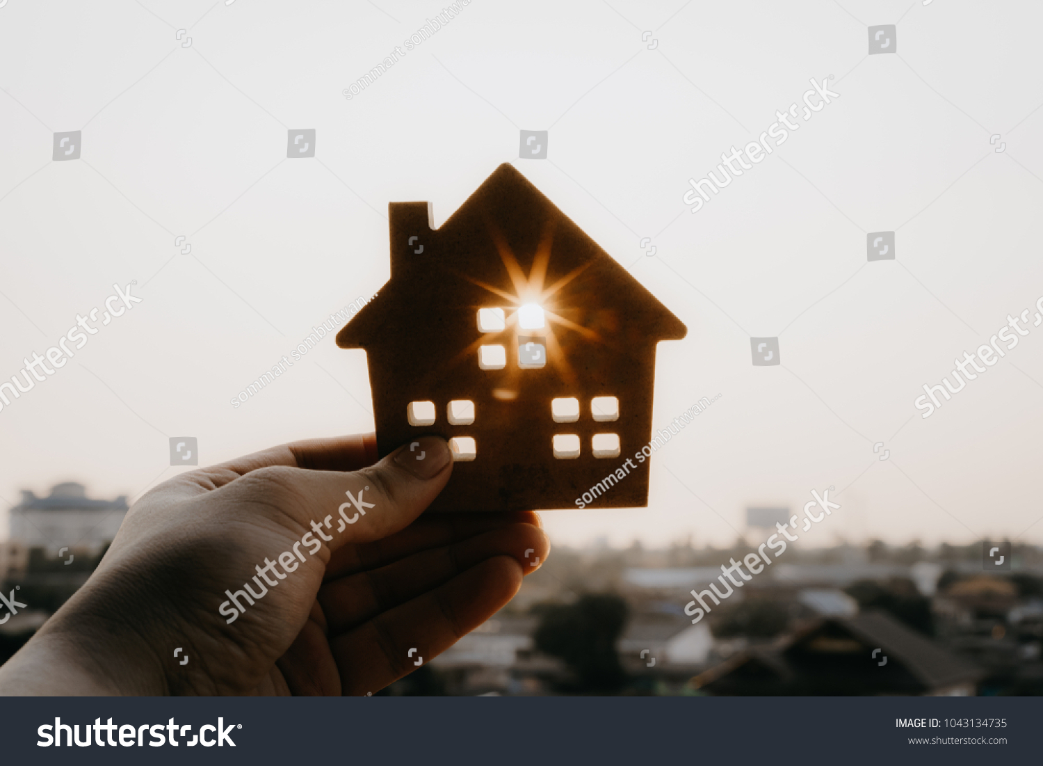 House model in home insurance broker agent 's hand or in salesman person. Real estate agent offer house, property insurance and security, affordable housing concepts #1043134735