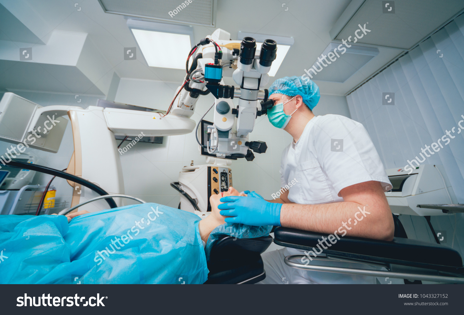 f50786d2866 Eye surgery. A patient and surgeon in the operating room during ophthalmic  surgery. Patient