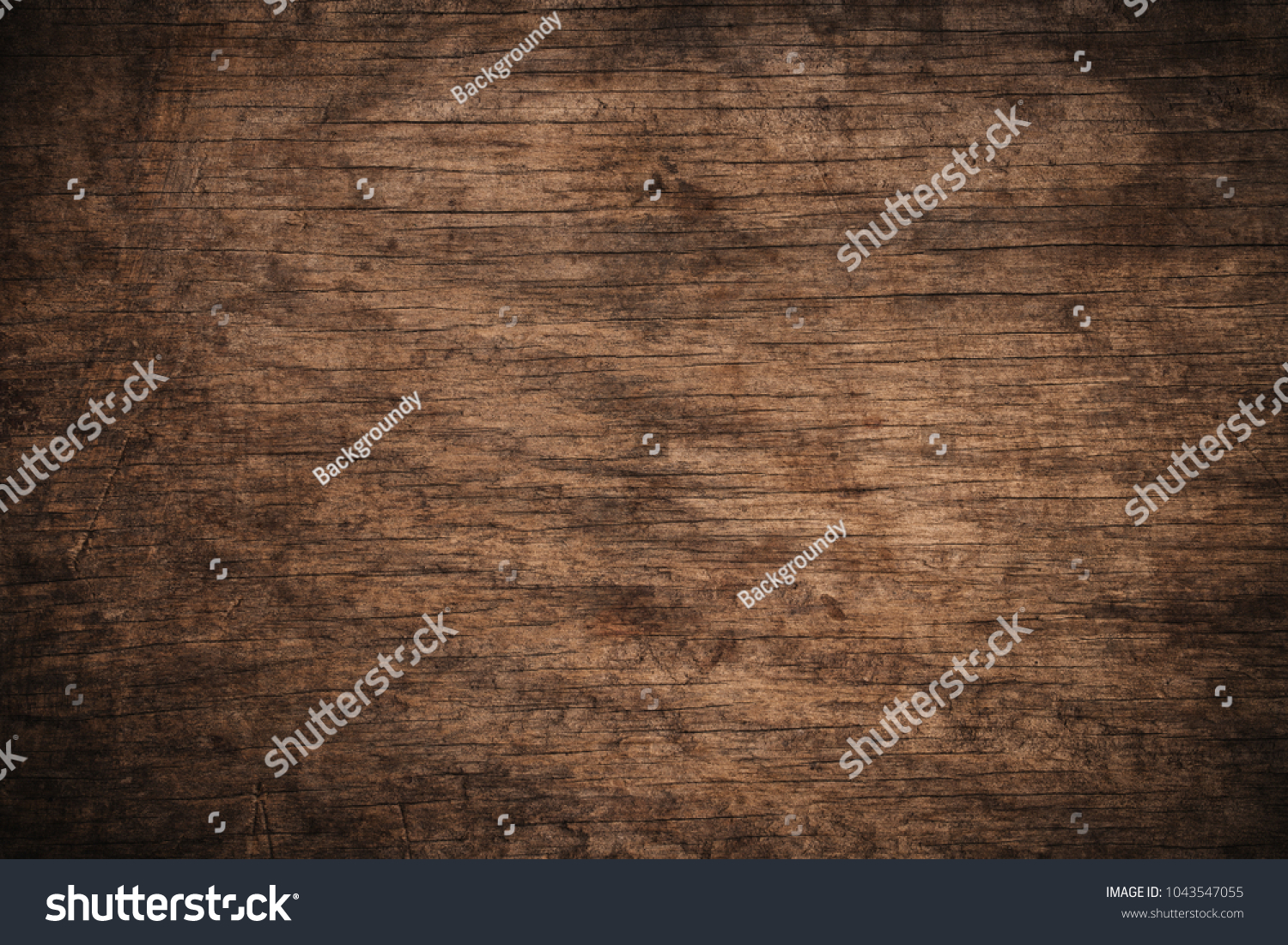 Old grunge dark textured wooden background,The surface of the old brown wood texture,top view brown wood panelitng #1043547055