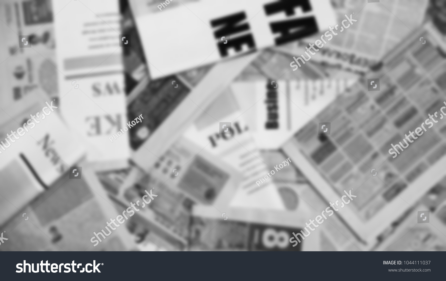 old newspapers scattered on horizontal surface stock photo (edit now