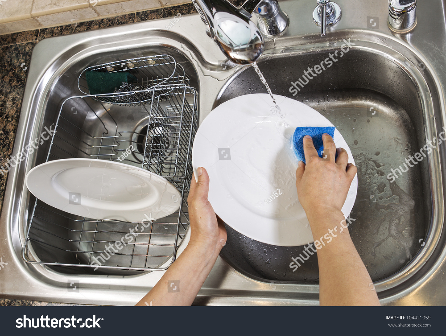 washing dishes in bathroom sink washing dishes with running water from faucet in 24563