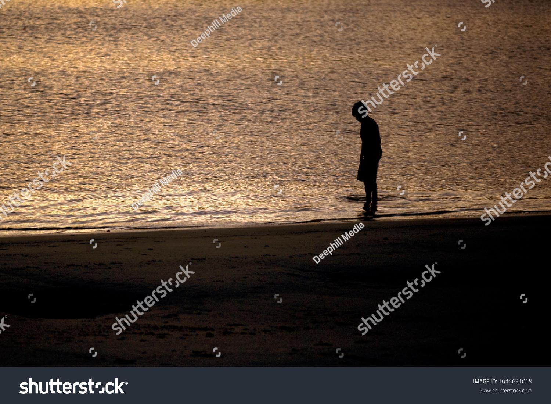 Boy Plays Shallows Beach Sunset Stock Photo (Edit Now