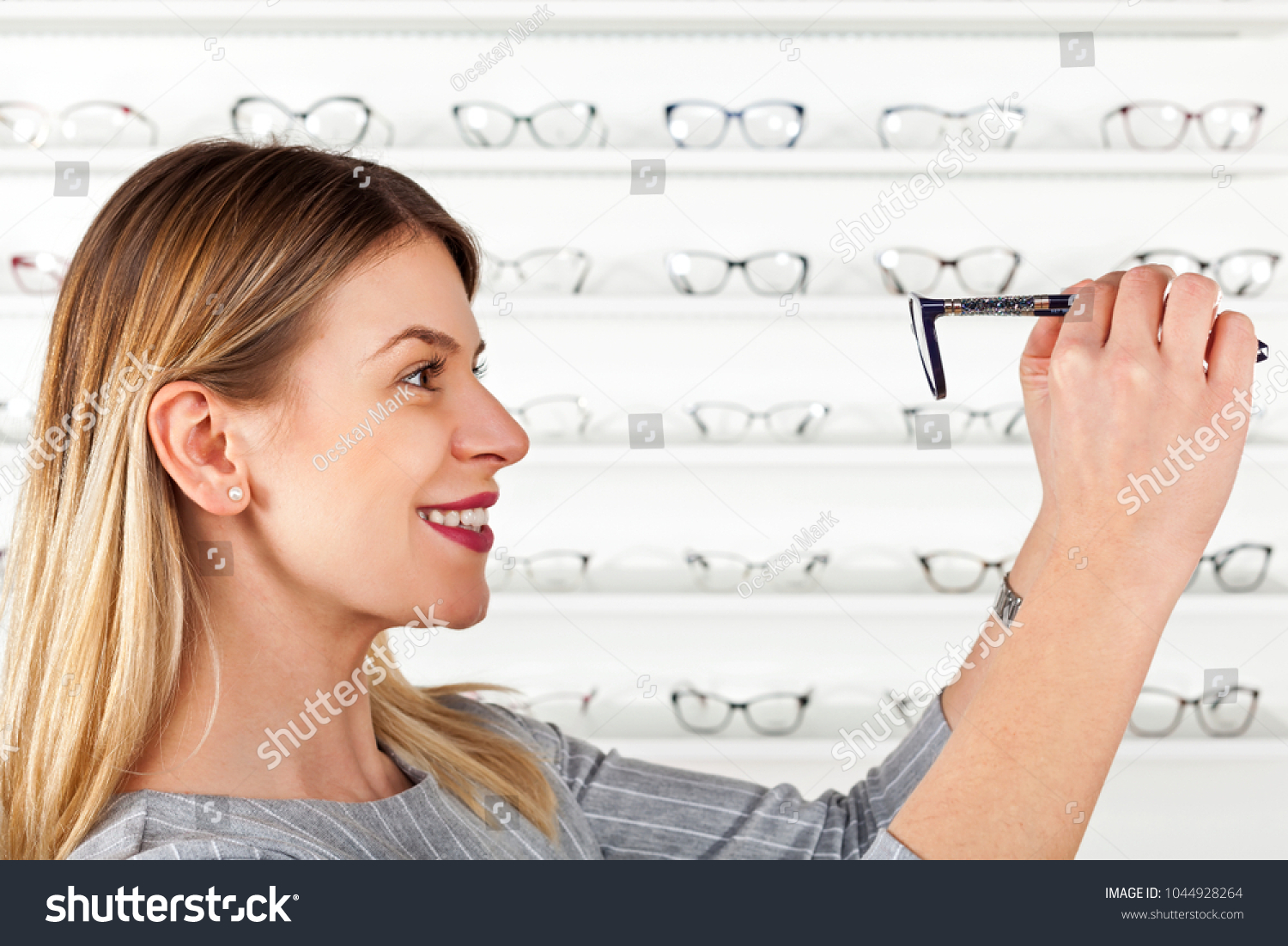 Attractive Young Woman Choosing Eyeglass Frame Stock Photo (Safe to ...
