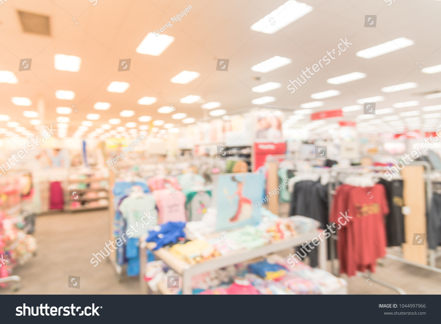 0d3dadf62 Blurred women and kids clothing department at discount store retailer in  America. Low prices fashion
