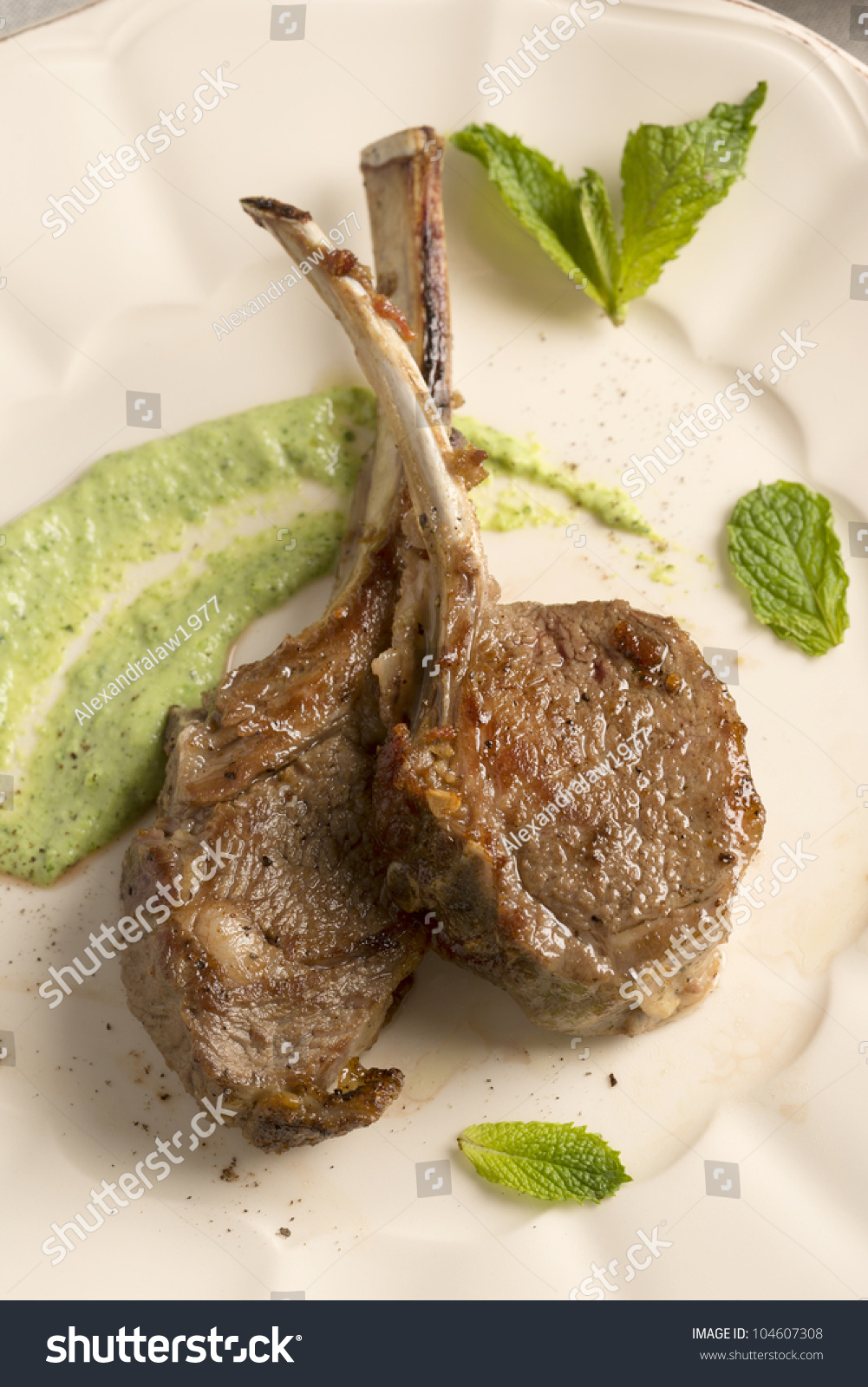 Lamb Chops With A Minted Pea Puree Stock Photo 104607308 ...