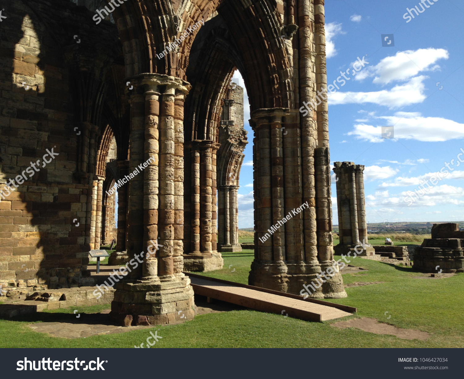 Pillars supporting the remains of an abandoned church in England, Europe.  Blue sky with