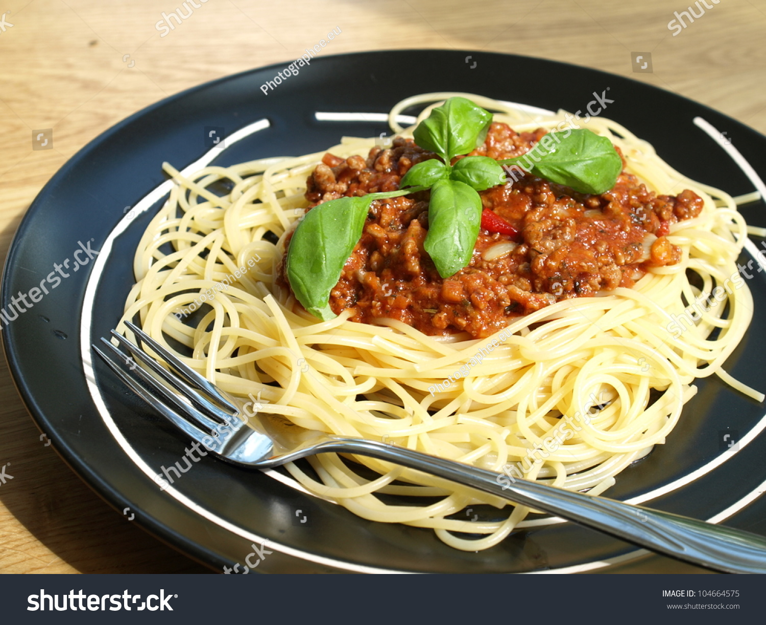 traditional italian dish spaghetti bolognese with basil stock photo 104664575 shutterstock. Black Bedroom Furniture Sets. Home Design Ideas
