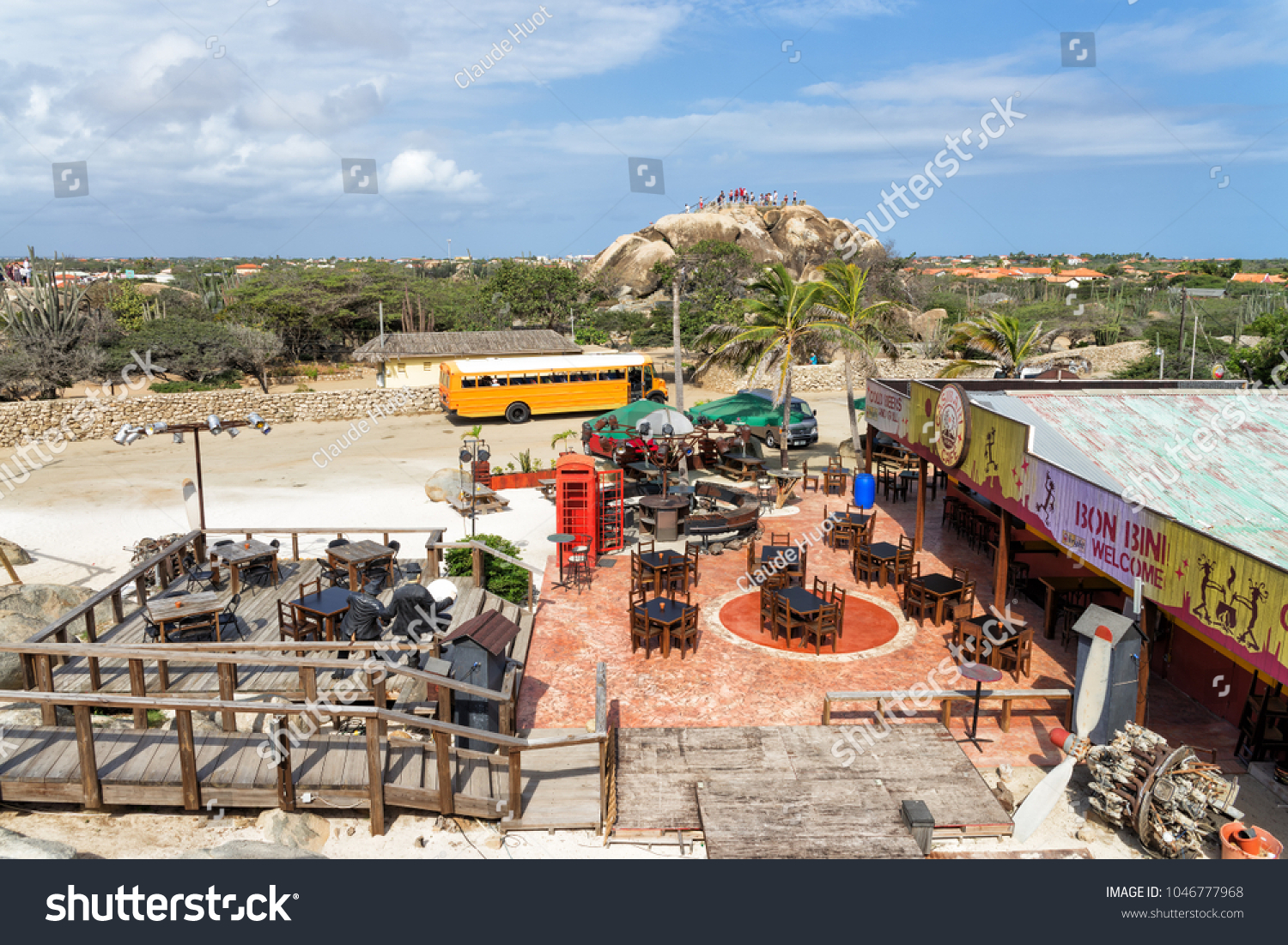 CASIBARI, ARUBA, CARIBBEAN - JANUARY 31, 2015: Tourists visit and climb the Casibari rock formation which offers a spectacular view from the top. There is a souvenir shop and cafeteria at the bottom.