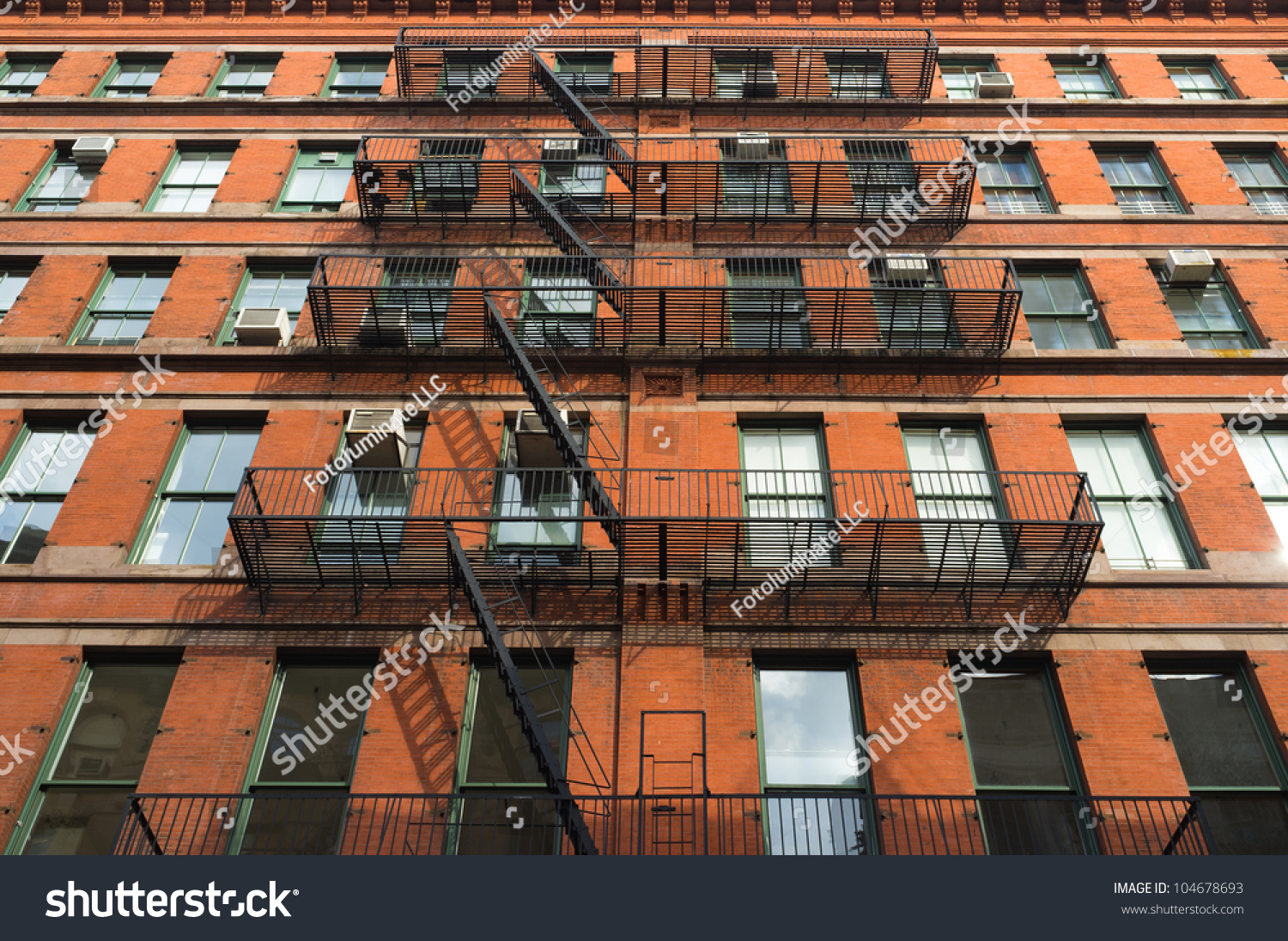 facade old red brick downtown apartment stock photo 104678693 shutterstock. Black Bedroom Furniture Sets. Home Design Ideas