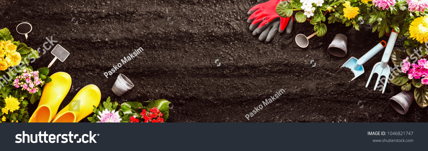 Gardening Tools on Soil Background. Spring Garden Works Concept