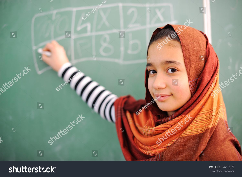 beautiful arab girl wearing hijab in school stock photo