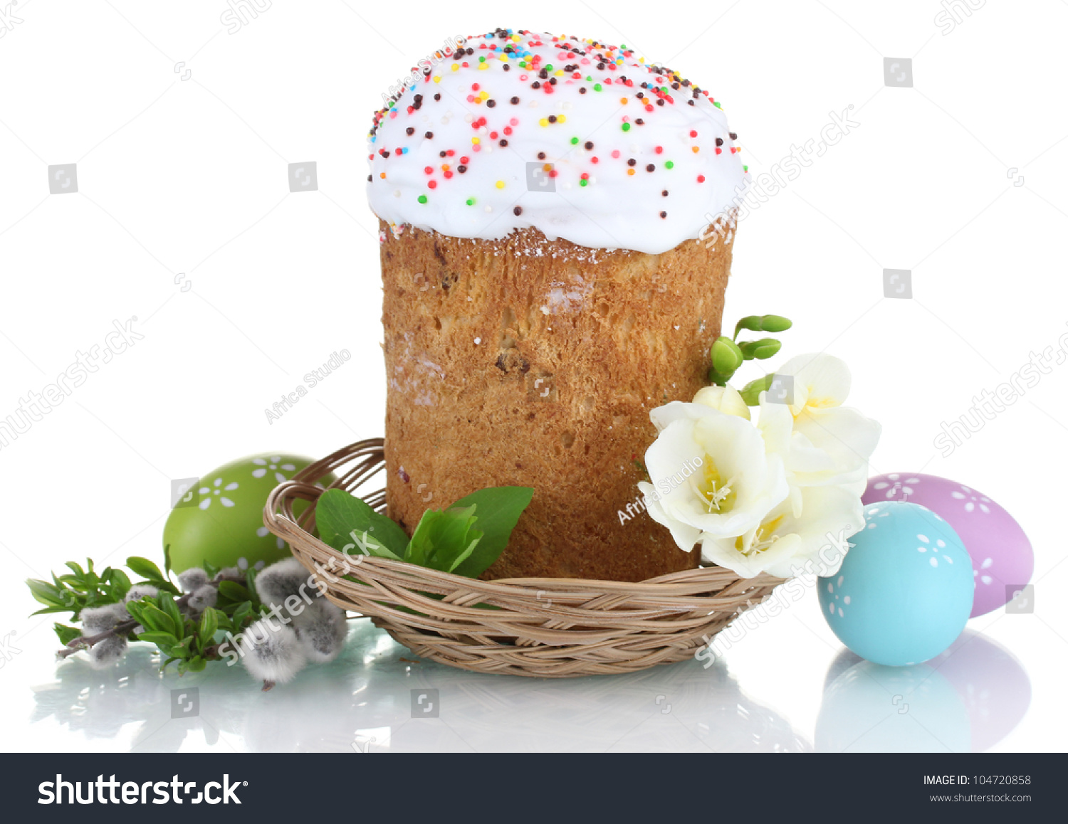 beautiful easter cake in basket colorful eggs and flowers