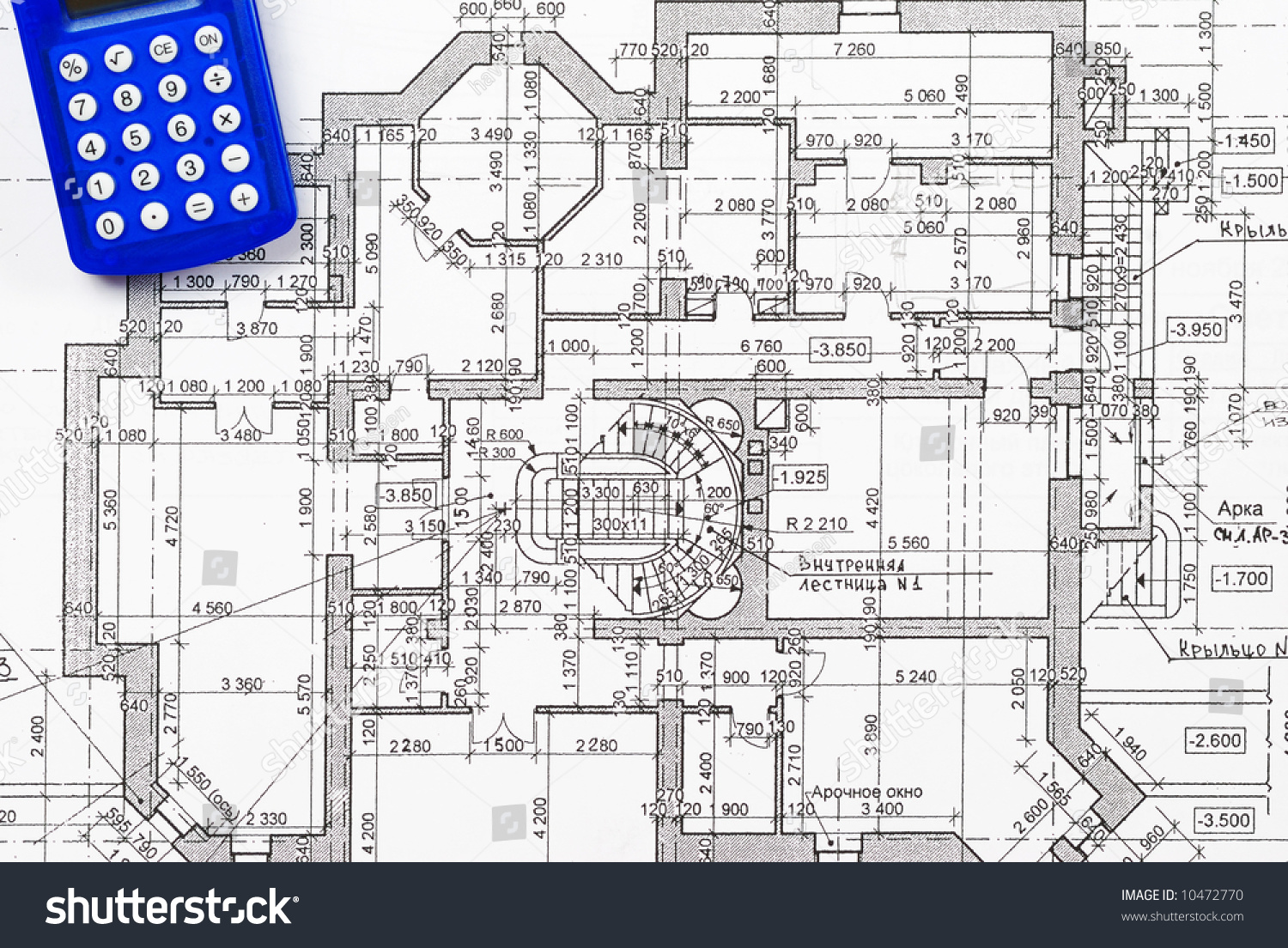 Calculator Over House Plan Blueprints Stock Photo 10472770