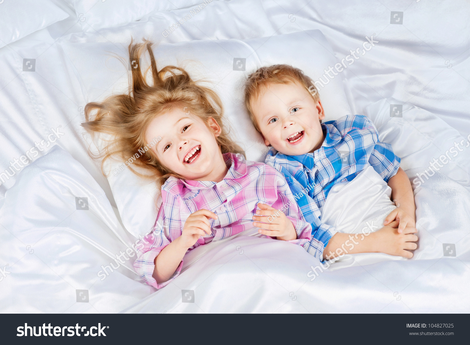 Happy little boy and girl in bed stock photo 104827025 for Boys and girls in bed