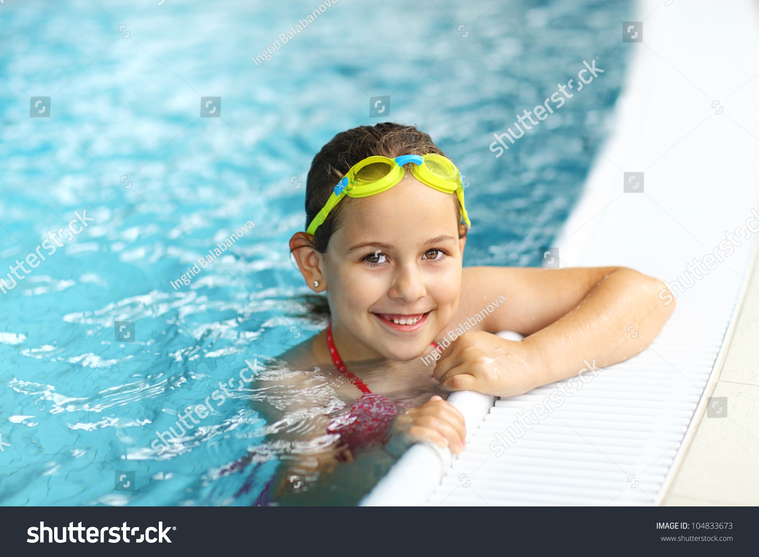 girls goggles wjzi  Cute girl with goggles in swimming pool