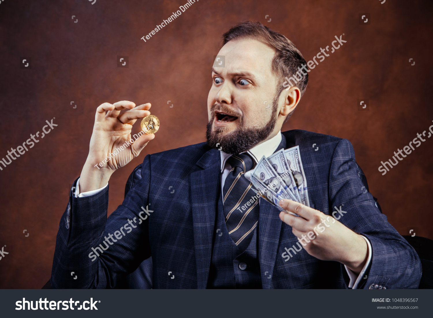 Businessman holding golden bitcoin ticker symbol stock photo businessman holding golden bitcoin ticker symbol btc and dollar banknotes finance money bitcoin concept buycottarizona Choice Image