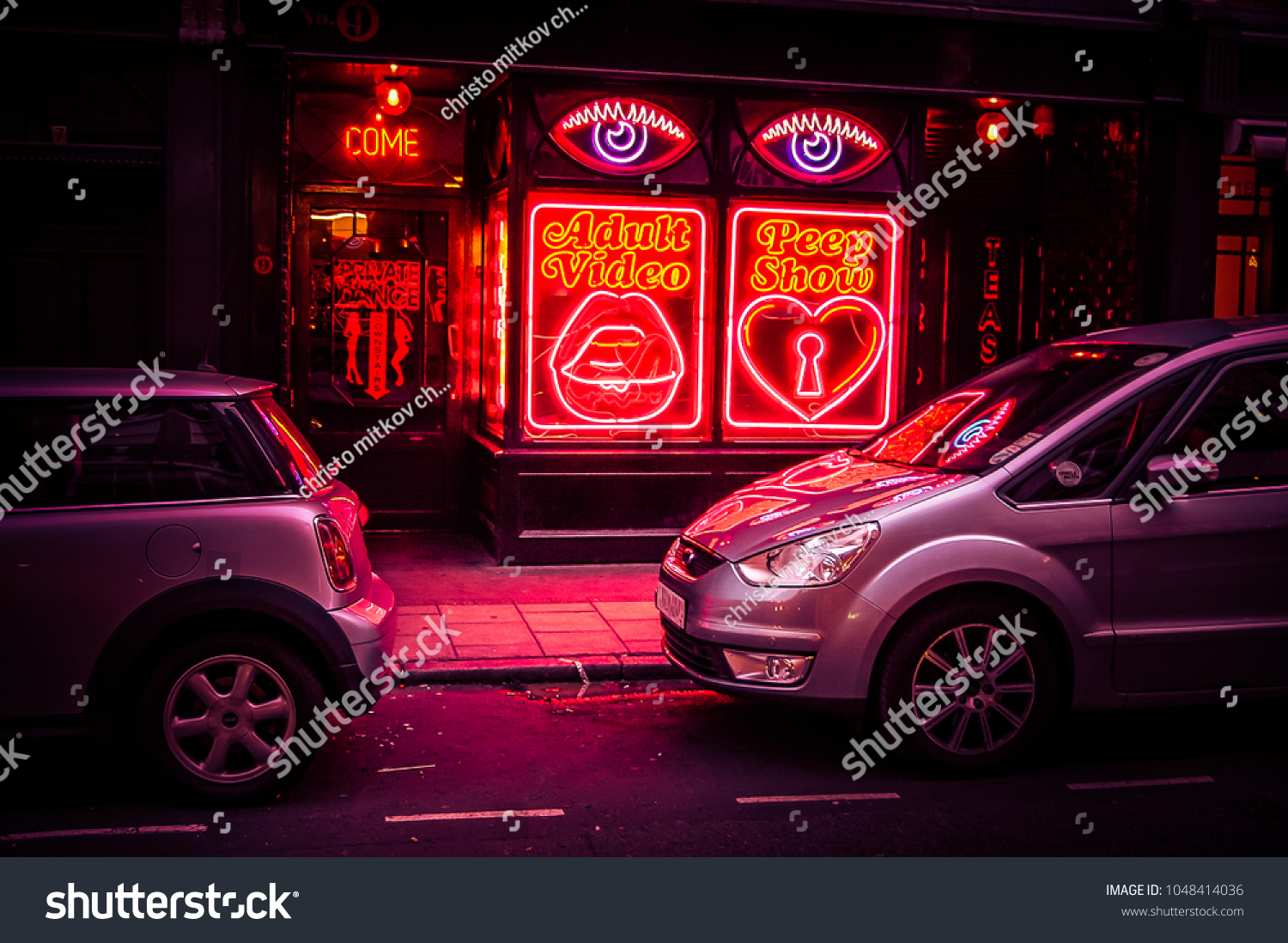 Adult video and peep show neon sign in Soho London-AUGUST 30 2014,LONDON