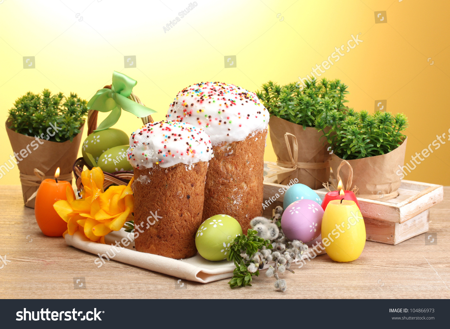 beautiful easter cakes colorful eggs and candles on wooden table on