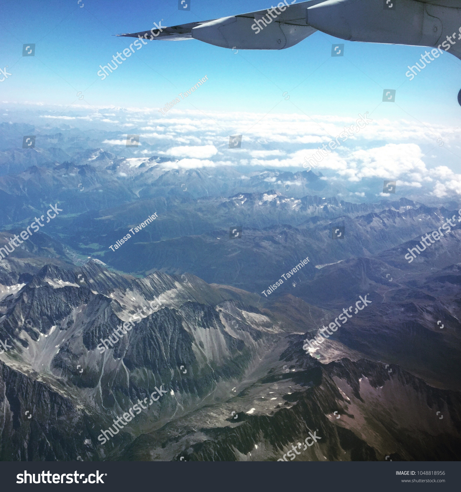 Plane Wing over Mountains #1048818956