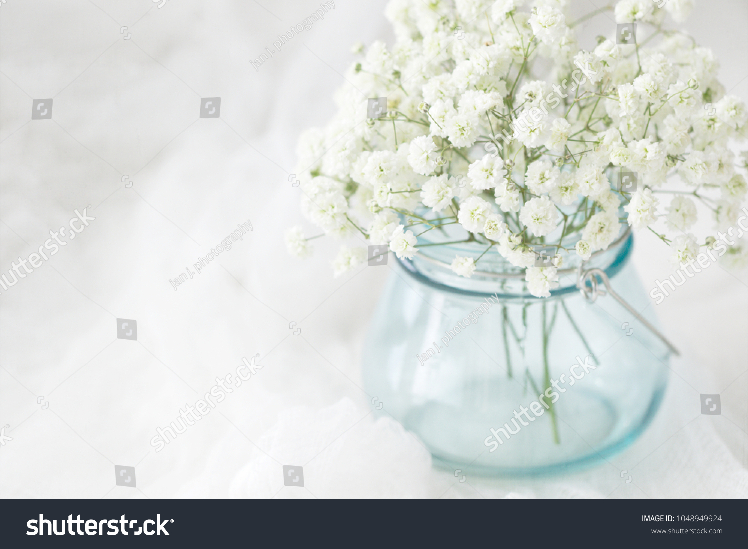 Photograph white breath flowers tiffany blue stock photo edit now photograph of white babys breath flowers in a tiffany blue glass jar izmirmasajfo