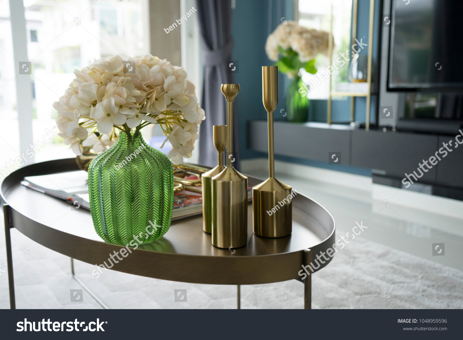 colorful and stylish living room with flower vase and gold trumpet on table. #1048959596