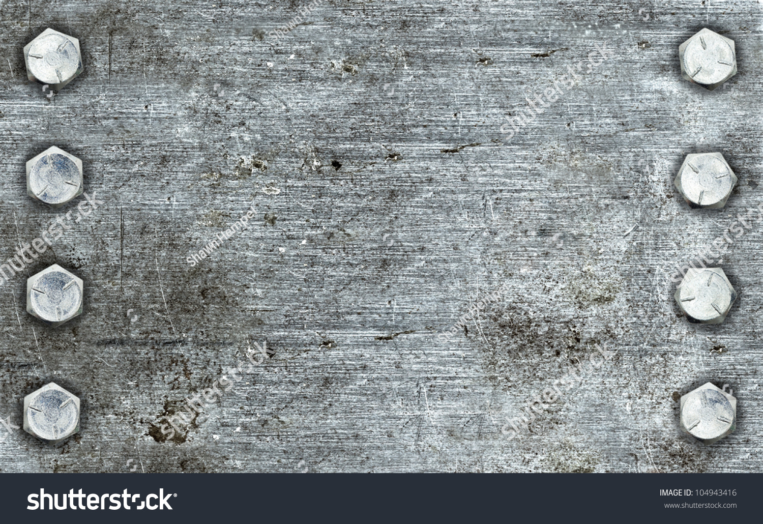 brushed metal background with two rows of bolts stock