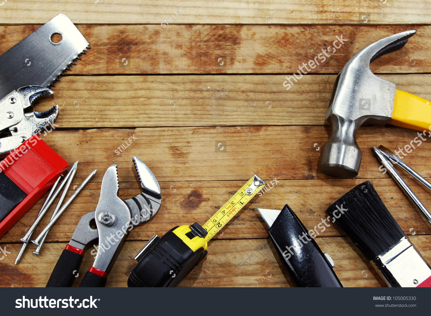Closeup of assorted work tools on wood #105005330