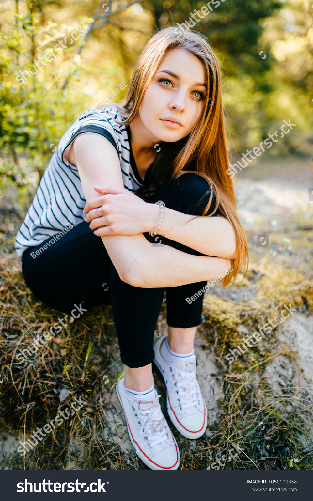 490616bdd550 Fashionable stylish teen with passionate expressive face posing at camera.  Blue eyed lovely fabulous brunette woman relaxing in summer wonderland -  Image