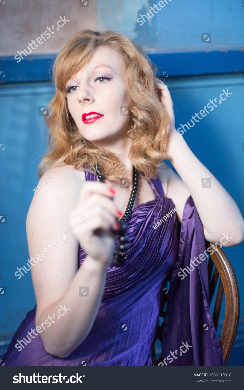 Sexy 1950 style red head female model, Retro film star glamour, purple  evening dress