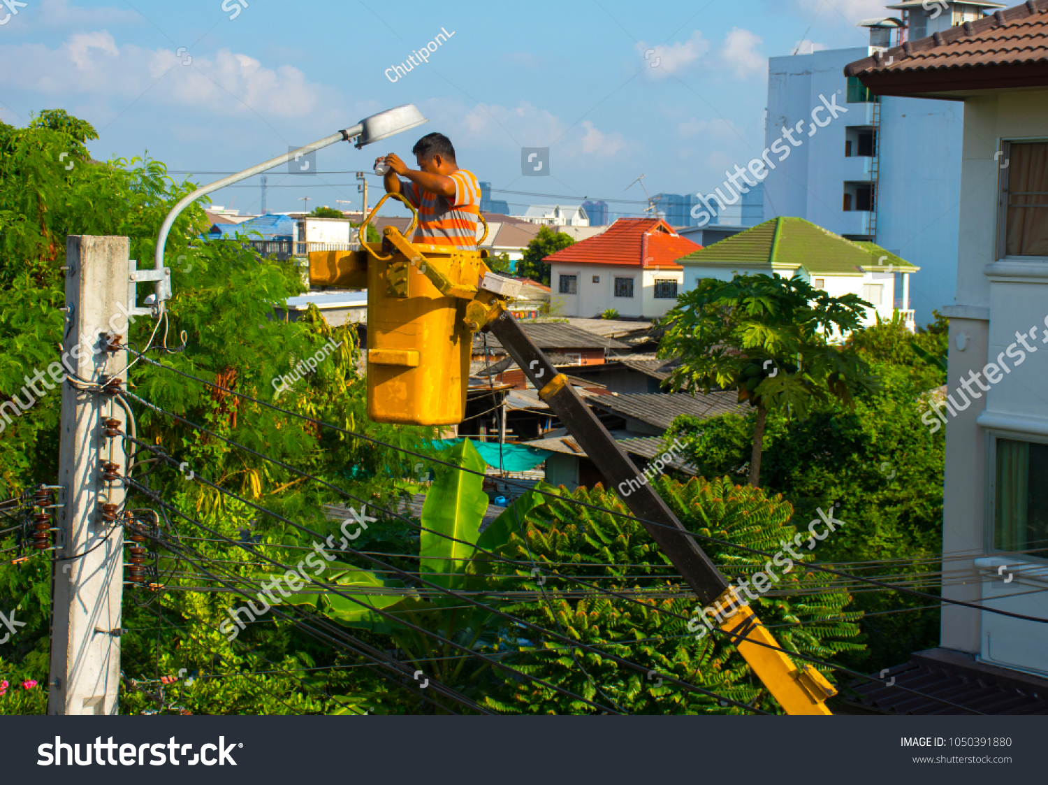 Electricians Using Lifting Boom Machinery Wiring Stock Photo Edit A Light Bulb The Change At Electric Pole