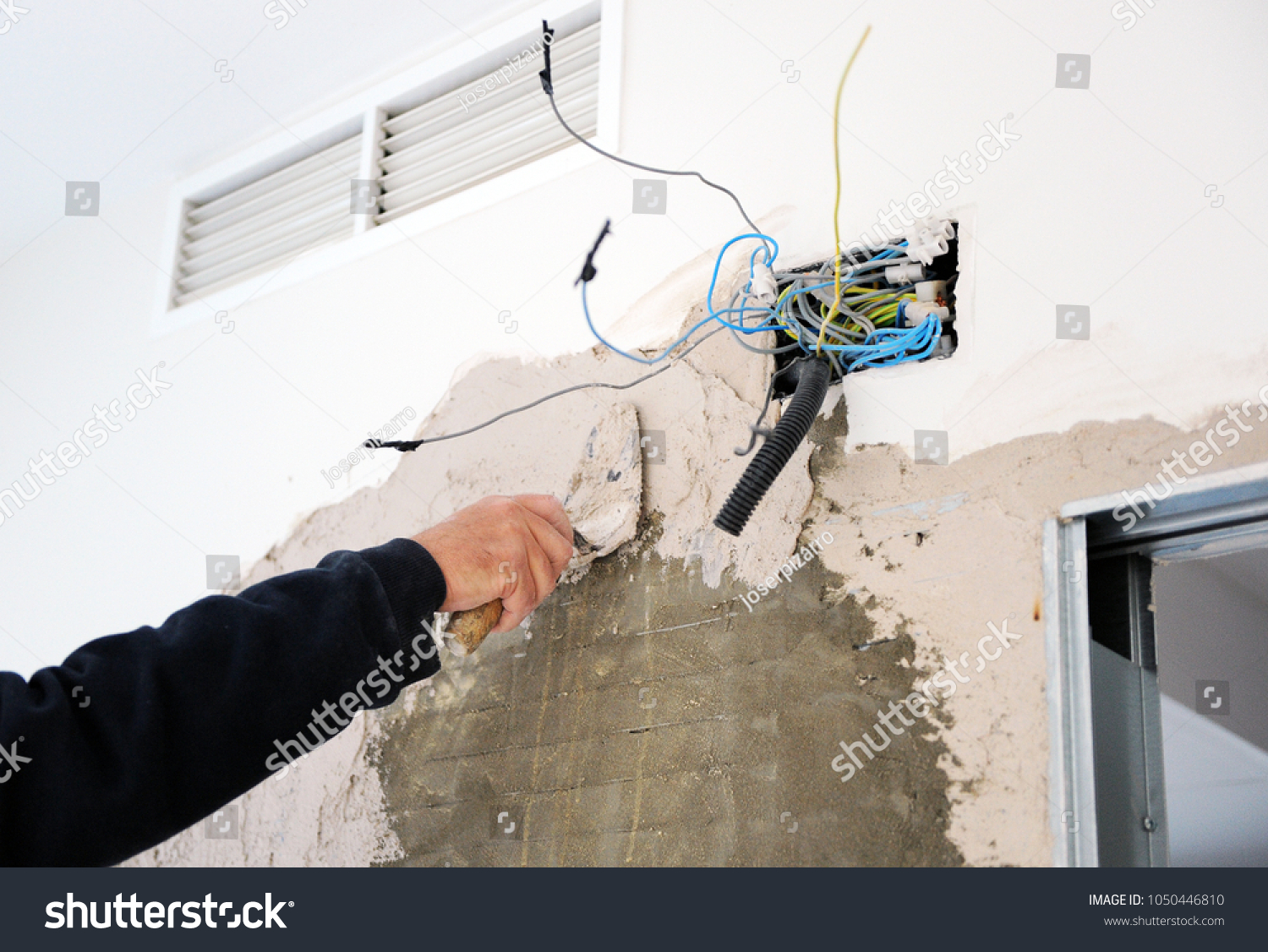 Plaster Wall During House Reform Plastering Stock Photo Edit Now Wiring Behind Walls The With Trowel A New Electrical Box