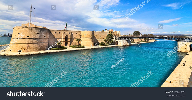 Taranto old Aragonese Castle on sea channel and revolving bridge