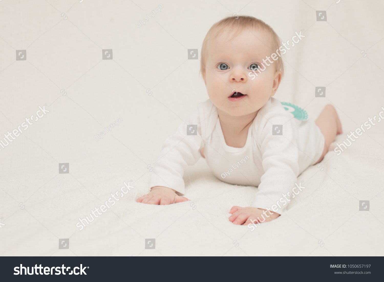 A 8 month old baby girl in front of a white background sticker 8