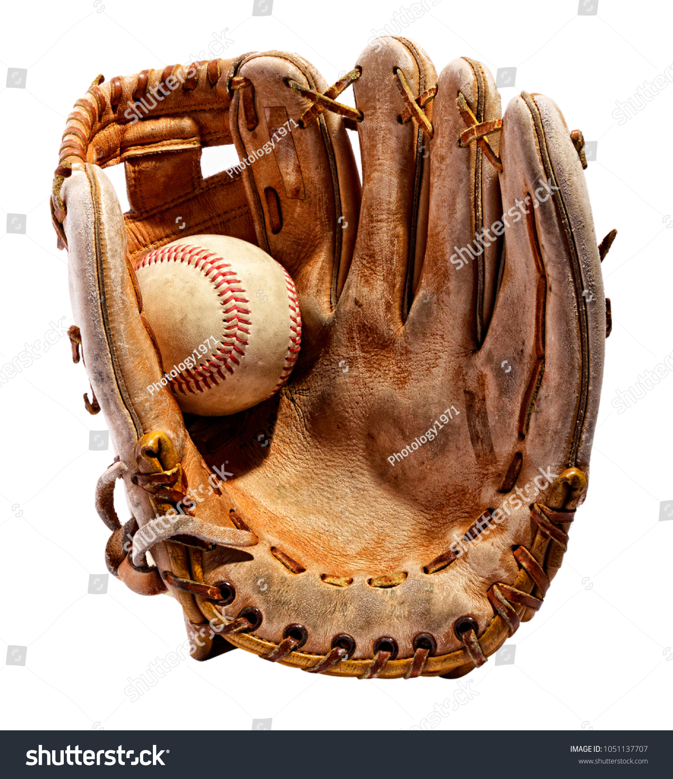 Vintage classic leather baseball glove from the palm side with the ball in it in close-up isolated on white background #1051137707