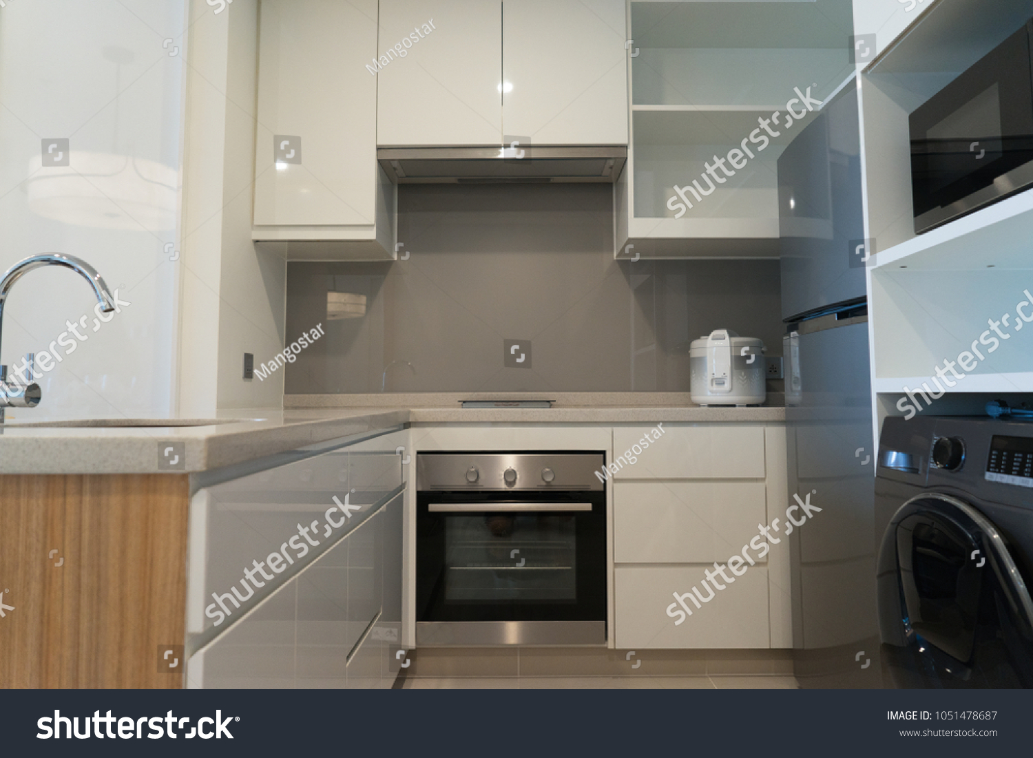 Modern kitchen with minimalist design small kitchen set equipped with appliances such like freezer