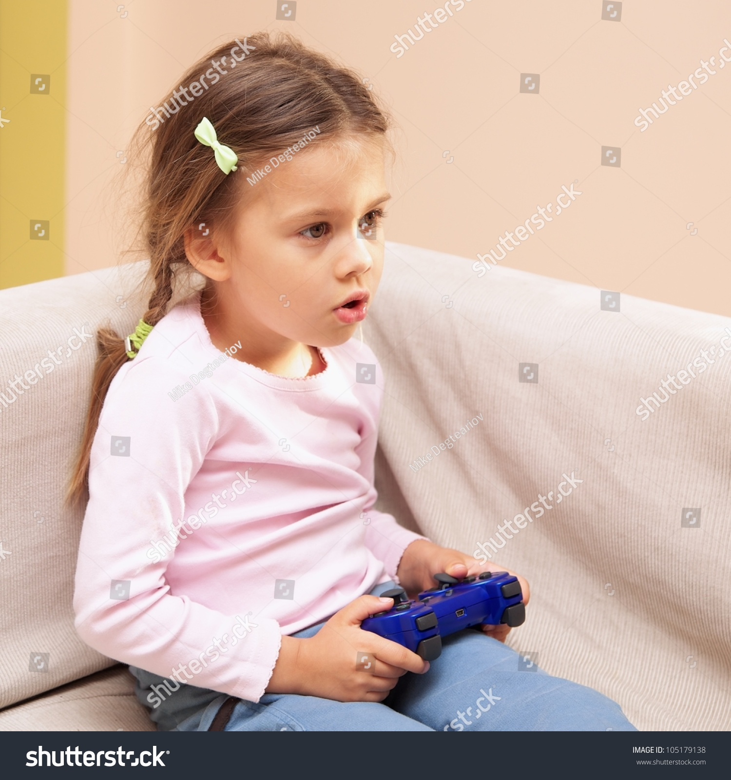 Young Girl Playing Video Game Blue Stock Photo 105179138 ...