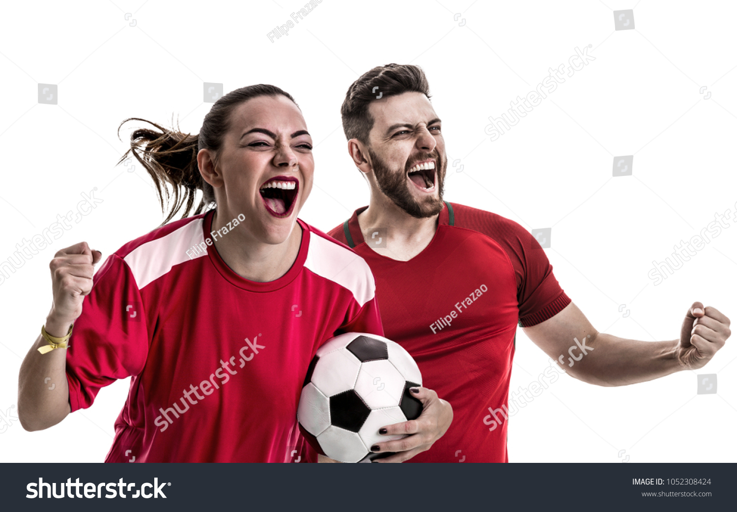 Young couple fan in red uniform celebrating #1052308424