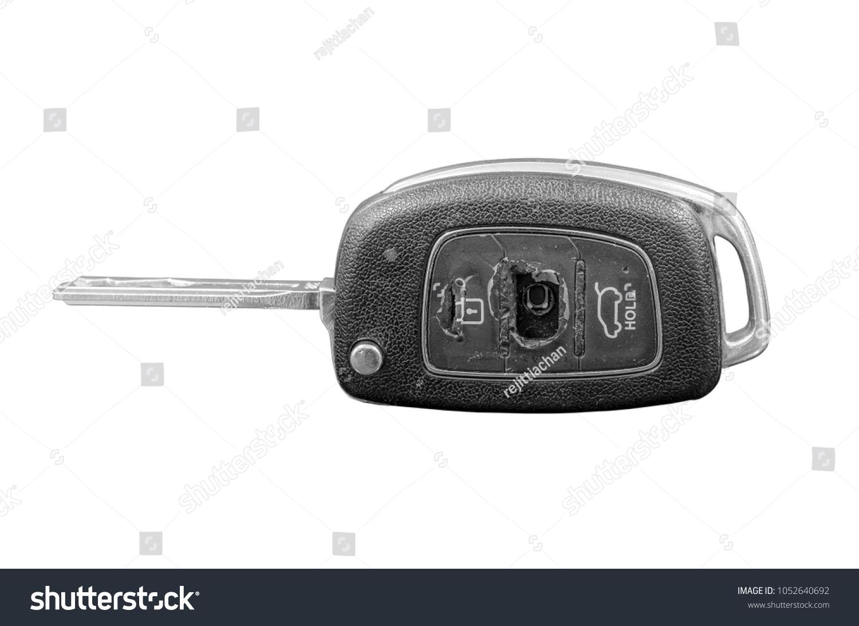 Close-up of a damaged car key isolated on white background.