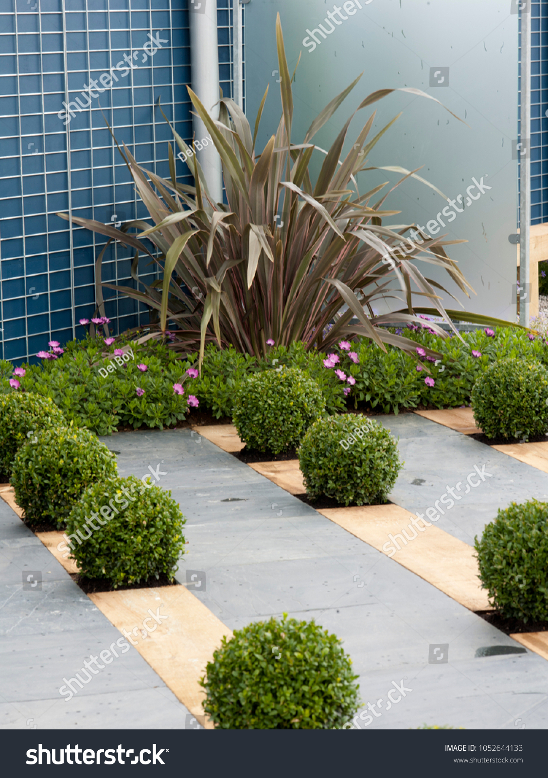 Modern Garden Creative Topiary Display Paved Stock Photo Edit Now 1052644133