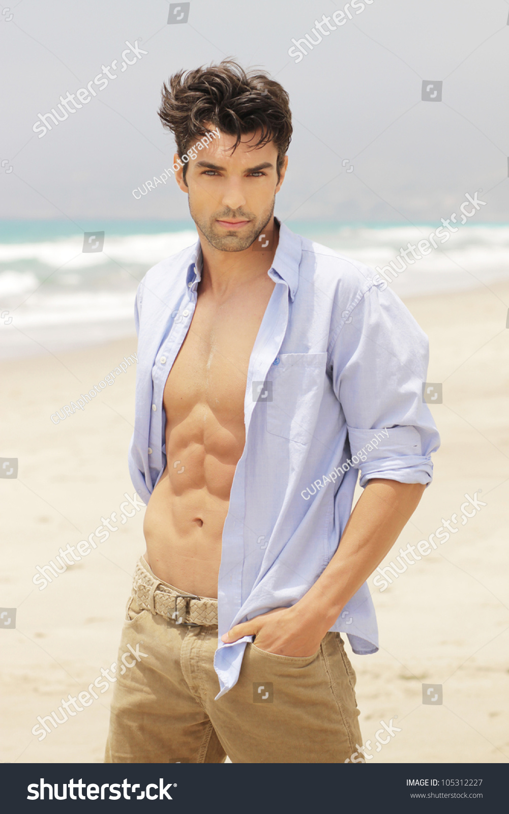 Goodlooking man on beach open shirt stock photo 105312227 for This guy has an awesome girlfriend shirt