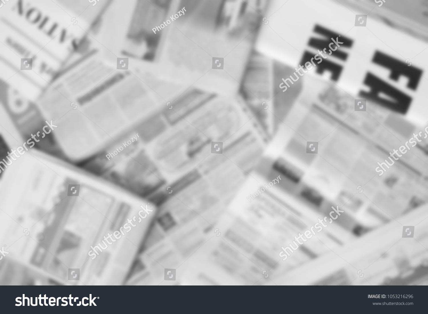 news concept newspapers scattered on horizontal stock photo (edit