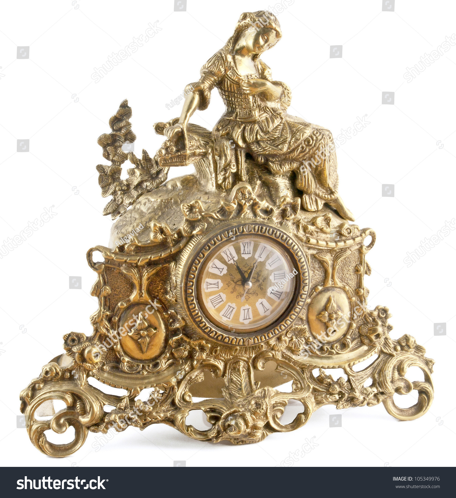 Decorative Table Clock In Bronze On A White Background