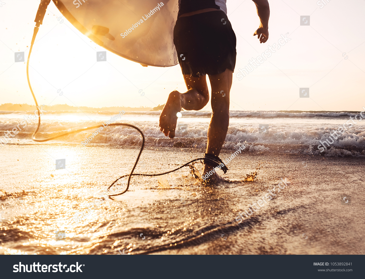 Man surfer run in ocean with surfboard. Active vacation, health lifestyle and sport concept image #1053892841